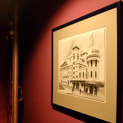 An historic picture of the Alhambra Theatre framed and on display in the entrance to the Alhambra Theatre