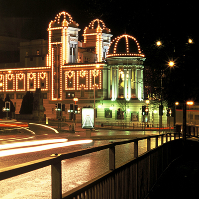 An evening view of the fully-lit Alhambra Theatre from Godwin Street, Bradford